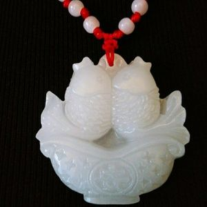 Jewelry - Pretty white Jade coy fish medallion.